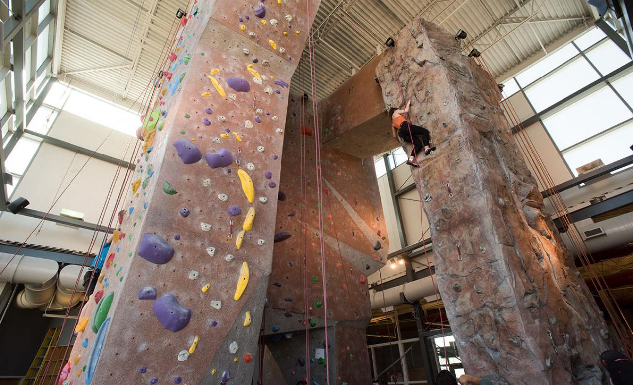 Broad view of the climbing walls at the Adventure Recreation Center