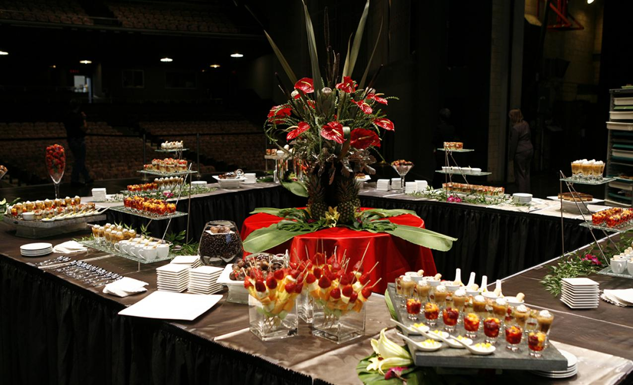 Image of centerpiece and desserts provided by University catering