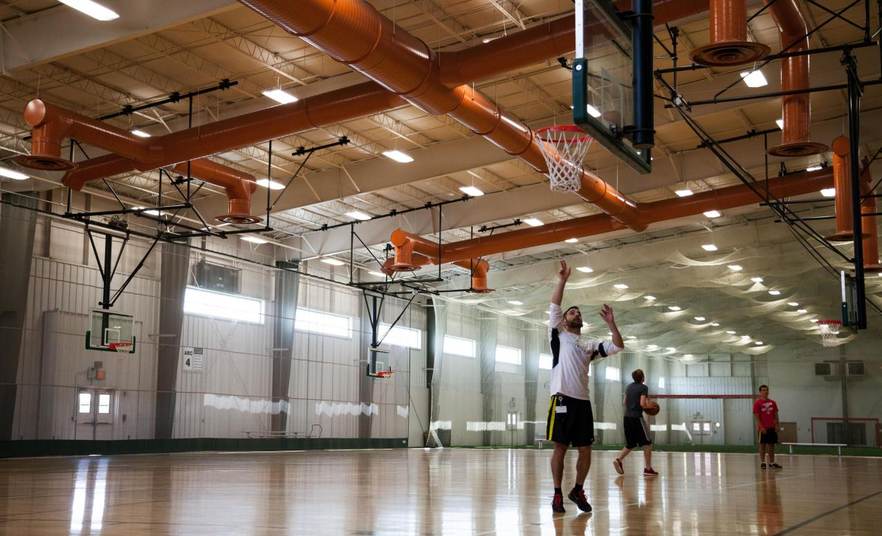 Wood-floored basketball court at the Adventure Recreation Center